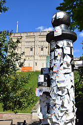 Norwich Castle admittance tickets stuck to pillar in front of the castle. UK May 2019