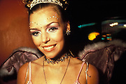 A woman in angel wings wearing eye make-up, Clubbing 1999