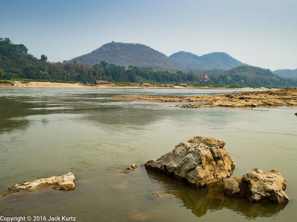 12 MARCH 2016 - LUANG PRABANG, LAOS:  The Mekong River near Luang Prabang. Laos is one of the poorest countries in Southeast Asia. Tourism and hydroelectric dams along the rivers that run through the country are driving the legal economy.      PHOTO BY JACK KURTZ
