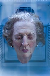 "© Licensed to London News Pictures. 23/05/2015.  London, UK. BLUE ICE LADY... With the recent UK general election still fresh in people's minds, a piece entitled ""Always Thatcher"" by Eugenio Merino catches the eye at Art15, a global art fair, currently taking place at Kensington Olympia. The head is suspended in a beverage refrigerator, has a price tag of £17,000 and is being presented by the Unix gallery of New York.  Photo credit : Stephen Chung/LNP"
