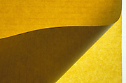 Folded sheet of yellow notepad