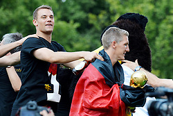 15.07.2014, Brandenburger Tor, Berlin, GER, FIFA WM, Empfang der Weltmeister in Deutschland, Finale, im Bild Bastian Schweinsteiger (GER) re. mit Pokal und Manuel Neuer, (Torhueter, GER) li, // during Celebration of Team Germany for Champion of the FIFA Worldcup Brazil 2014 at the Brandenburger Tor in Berlin, Germany on 2014/07/15. EXPA Pictures © 2014, PhotoCredit: EXPA/ Eibner-Pressefoto/ Harzer<br /> <br /> *****ATTENTION - OUT of GER*****