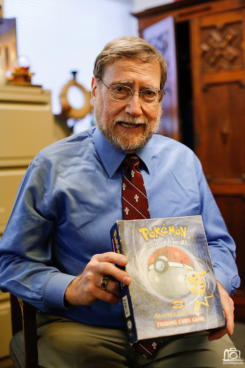 Rev. Bruce Buchanan holds a Pokémon trading card game box as an example of where gun owners store their guns during a gun buy-back in The Stewpot parking garage in Dallas, Texas, on January 19, 2013.  The trading card game box was turned in with a handgun during a previous First Presbyterian Church of Dallas gun buy-back.  (Stan Olszewski/The Dallas Morning News)