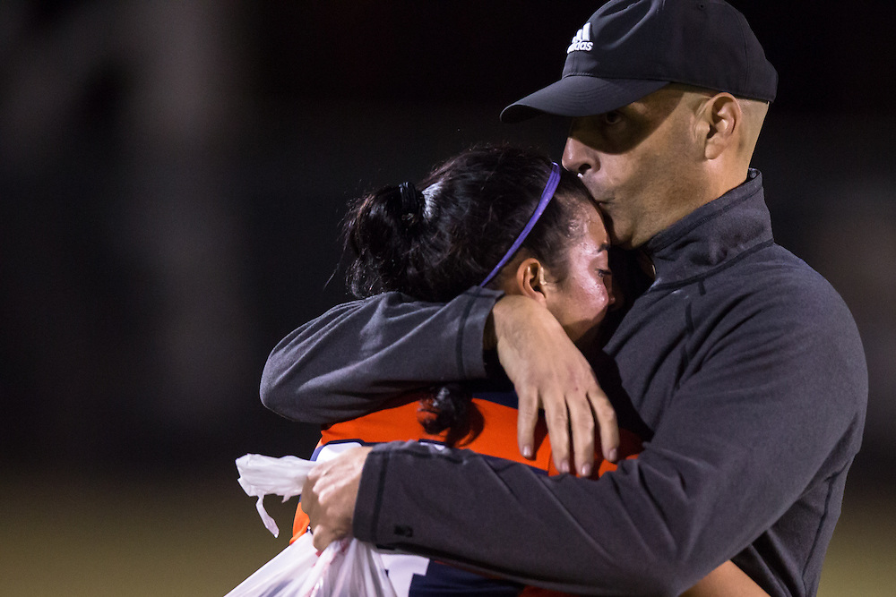 November 2, 2016; Coach hugs player after loss at Fullerton College vs UC Irvine Womens Soccer Semi Final at Big West Conference at LBSU ; Long Beach, CA;  <br /> &copy; photo by Catharyn Hayne/Sport Shooter Academy