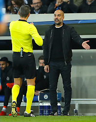 Manchester City manager Pep Guardiola speaks with referee Damir Skomina