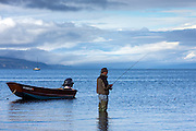 Fly fishing for salmon from a skiff on Katchemak Bay near Homer, Alaska.