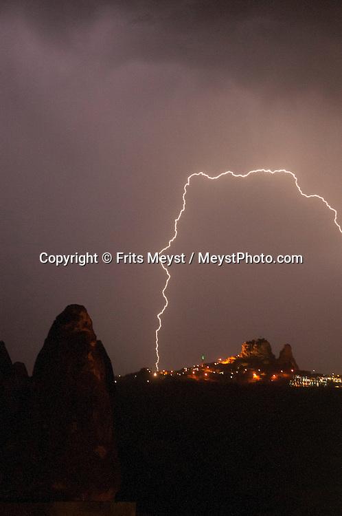 Goreme National Park, Cappadocia, Nevsehir, Turkey, August 2012.Lightning strikes the Kale (castle) of Uchisar village during a summer thunderstorm.  Photo By Frits Meyst/Adventure4ever.com
