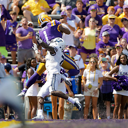 Oct 5, 2019; Baton Rouge, LA, USA; LSU Tigers wide receiver Ja'Marr Chase (1) catches a touchdown over Utah State Aggies cornerback DJ Williams (7) during the first half at Tiger Stadium. Mandatory Credit: Derick E. Hingle-USA TODAY Sports