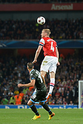 LONDON, ENGLAND - Oct 01: Arsenal's defender Per Mertesacker from Germany  heads the ball during the UEFA Champions League match between Arsenal from England and Napoli from Italy played at The Emirates Stadium, on October 01, 2013 in London, England. (Photo by Mitchell Gunn/ESPA)