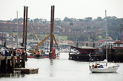 The Haven Seajack One, towed by the Pilot boat St Hilda and assisted by the tug Workboat VOE Service navigates through the swing bridge in Whitby Harbor on its way out to start work on the East Pier...September 2010 Images © Paul David Drabble