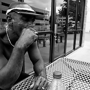Daly takes a break to smoke a cigarette in front of the Domino's Pizza on N. Big Spring St.