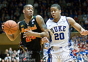 Maryland Terrapins guard/forward Cliff Tucker (24) brings ball up court guarded by Duke Blue Devils guard Andre Dawkins (20). Duke beats Maryland 71-64 at Cameron Indoor Stadium