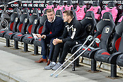 Milton Keynes Dons manager Karl Robinson chats to Injured Milton Keynes Dons defender Scott Wootton (5) on crutches during the EFL Sky Bet League 1 match between Milton Keynes Dons and Bury at stadium:mk, Milton Keynes, England on 27 September 2016. Photo by Dennis Goodwin.