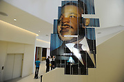 A portrait of Martin Luther King Jr. hangs near his exhibit on the first floor of the National Center for Civil and Human Rights during a walk-through at the new facility Tuesday, June 10, 2014, in Atlanta. David Tulis / AJC Special