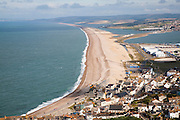 Chesil beach tombolo with housing in Chiswell in the foreground, Isle of Portland, Dorset, England