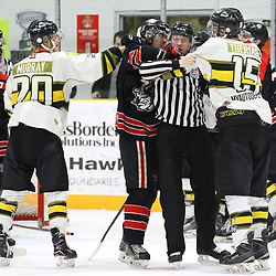"TRENTON, ON  - MAY 5,  2017: Canadian Junior Hockey League, Central Canadian Jr. ""A"" Championship. The Dudley Hewitt Cup Game 7 between Georgetown Raiders and the Powassan Voodoos.    Dayton Murray #20 and  Ryan Theriault #15 of the Powassan Voodoos go after Austin Cho #20 of the Georgetown Raiders during the third period<br /> (Photo by Alex D'Addese / OJHL Images)"