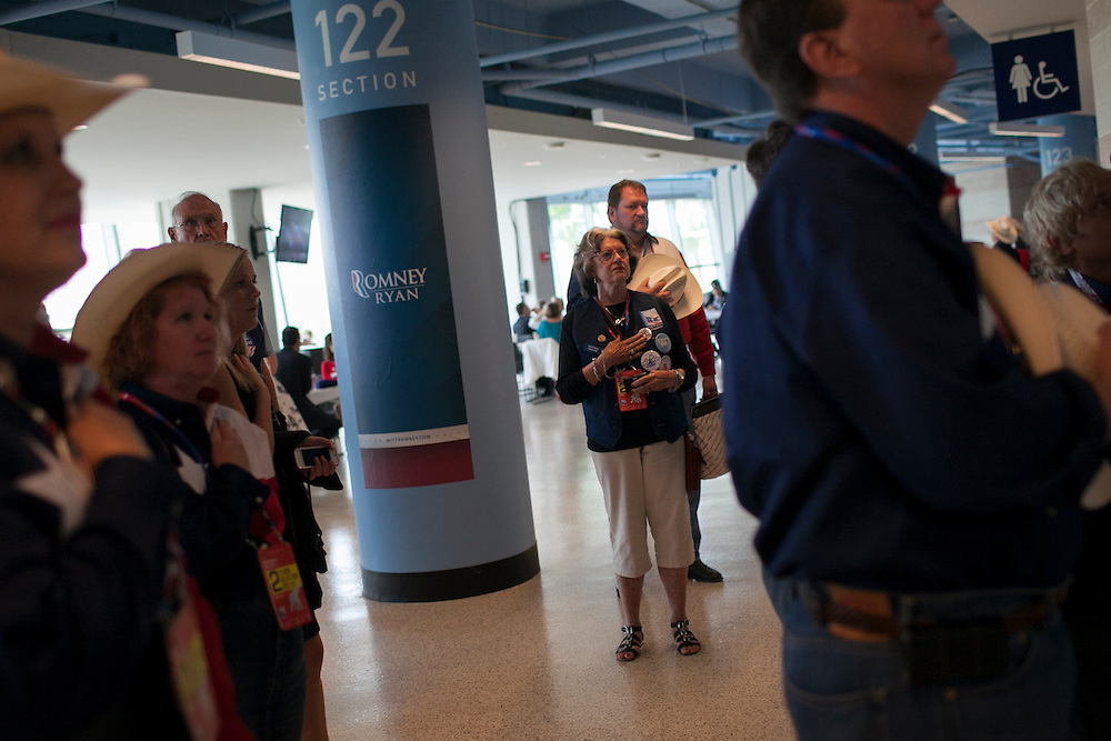 Attendees to day 2 of the RNC stand for the Pledge of Allegiance in Tampa, FL, on Tuesday, Aug. 28, 2012. ..Photograph by Andrew Hinderaker for TIME.