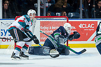 KELOWNA, CANADA - JANUARY 5: Jack Cowell #8 of the Kelowna Rockets looks for the pass in front of the net of Liam Hughes #30 of the Seattle Thunderbirds on January 5, 2017 at Prospera Place in Kelowna, British Columbia, Canada.  (Photo by Marissa Baecker/Shoot the Breeze)  *** Local Caption ***