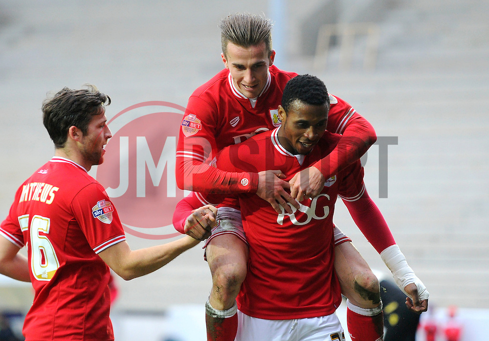 Jonathan Kodjia of Bristol City celebrates with Joe Bryan of Bristol City   - Mandatory byline: Joe Meredith/JMP - 19/03/2016 - FOOTBALL - Ashton Gate - Bristol, England - Bristol City v Bolton Wanderers - Sky Bet Championship