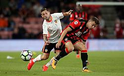 Federico Cartabia of Valencia is tackled by Matt Butcher of Bournemouth - Mandatory by-line: Robbie Stephenson/JMP - 03/08/2016 - FOOTBALL - Vitality Stadium - Bournemouth, England - AFC Bournemouth v Valencia - Pre-season friendly