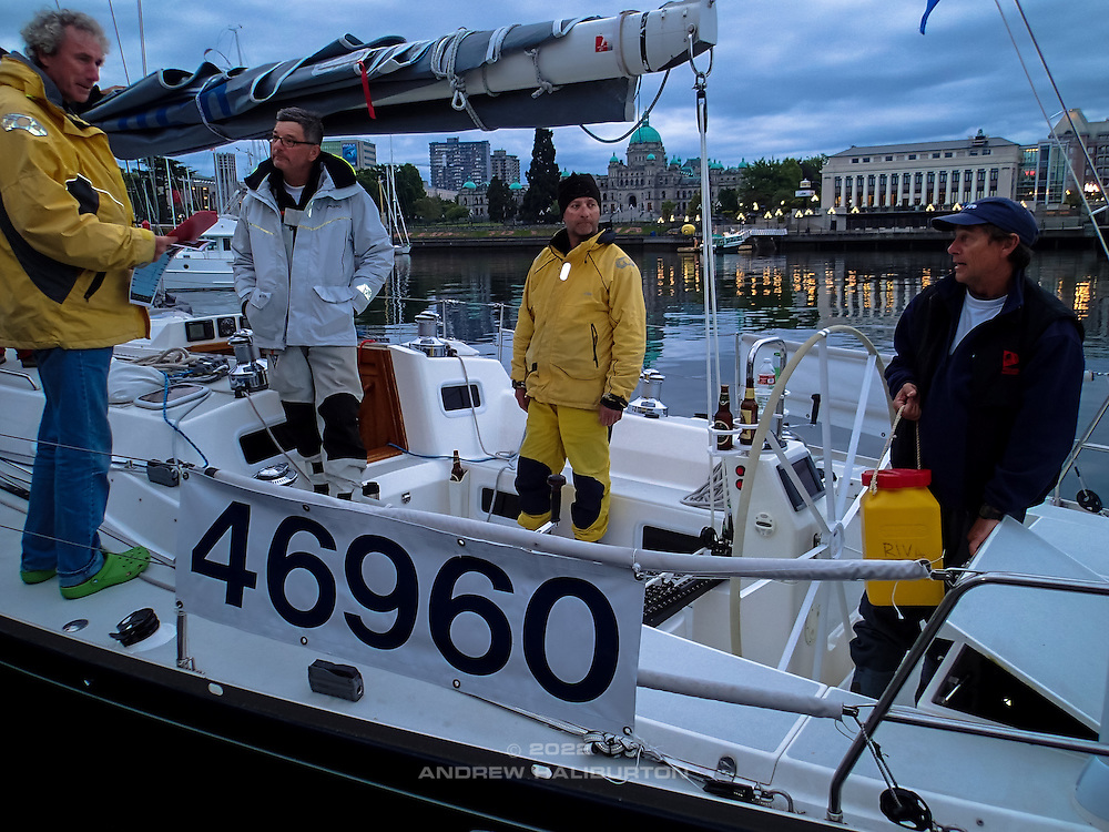 Safety officer checks Riva's emergency equipment at the finish, with Scott Campbell, Blain Goold and Dave Moran, dawn, Victoria Harbour.  2014 Swiftsure International Yacht Race, Victoria, British Columbia, Canada.  Olympus Tough TG-1.