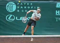 April 13, 2018 - Houston, TX, U.S. - HOUSTON, TX - APRIL 13:  Taylor Fritz of the United States watches his serve in the match against Jack Sock of the United States during the Quarterfinal round of the Men's Clay Court Championship on April 13, 2018 at River Oaks Country Club in Houston, Texas.  (Photo by Leslie Plaza Johnson/Icon Sportswire) (Credit Image: © Leslie Plaza Johnson/Icon SMI via ZUMA Press)
