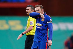 Wayne Rooney of Manchester United looks frustrated after missing with a free kick as referee Michael Oliver looks on - Photo mandatory by-line: Rogan Thomson/JMP - 07966 386802 - 01/01/2015 - SPORT - FOOTBALL - Stoke-on-Trent, England - Britannia Stadium - Stoke City v Manchester United - New Year's Day Football - Barclays Premier League.