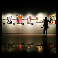 Washington, DC: September 30, 2014--- A visitor to the Newseum in Washington, DC looks at an exhibit of Pulitzer Prize winning photographs. © Audrey C. Tiernan