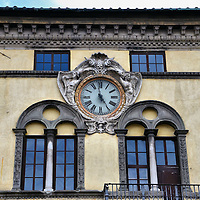 Clock on Pretorio Palace in Lucca, Italy <br /> This wonderful clock graces the top of a two-story building called the Pretorio Palace.  It was built overlooking the Piazza San Michele in the late 15th century in Lucca, Italy.  Designed by architect Matteo Civitali, this Renaissance building originally served the city council but now it houses the Magistrate's court.
