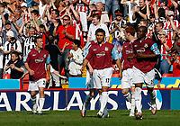 Photo: Paul Greenwood.<br />Sheffield United v West Ham United. The Barclays Premiership. 14/04/2007.<br />West Ham's Hayden Mullins (C) and Nigel Reo-Coker walk back to their half after Sheffield United score