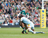 Picture by Andrew Tobin/Focus Images Ltd +44 7710 761829.25/05/2013. Courtney LAWES of Northampton late tackles Toby Flood (C) of Leicester for a 2nd time during the Aviva Premiership match at Twickenham Stadium, Twickenham.
