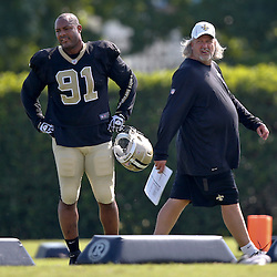 Jul 29, 2013; Metairie, LA, USA; New Orleans Saints defensive coordinator Rob Ryan and linebacker Will Smith (91) during a morning training camp practice at the team facility.  Mandatory Credit: Derick E. Hingle-USA TODAY Sports