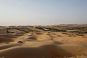 "Liwa Oasis surrounded by the vast sand dunes of the Rub'al Khali (""Empty Quarter"")."