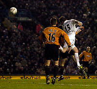 Photo. Jed Wee, Digitalsport<br /> Leeds United v Wolverhampton Wanderers, FA Barclaycard Premiership, Elland Road, Leeds. 10/02/2004.<br /> Leeds' Steven Caldwell (R) rises to head the ball goalwards, and in the subsequent confusion Alan Smith nets the opening goal.