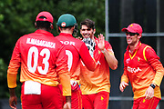 Graeme Cremer is congratulated on taking a wicket during the One Day International match between Scotland and Zimbabwe at Grange Cricket Club, Edinburgh, Scotland on 17 June 2017. Photo by Kevin Murray.