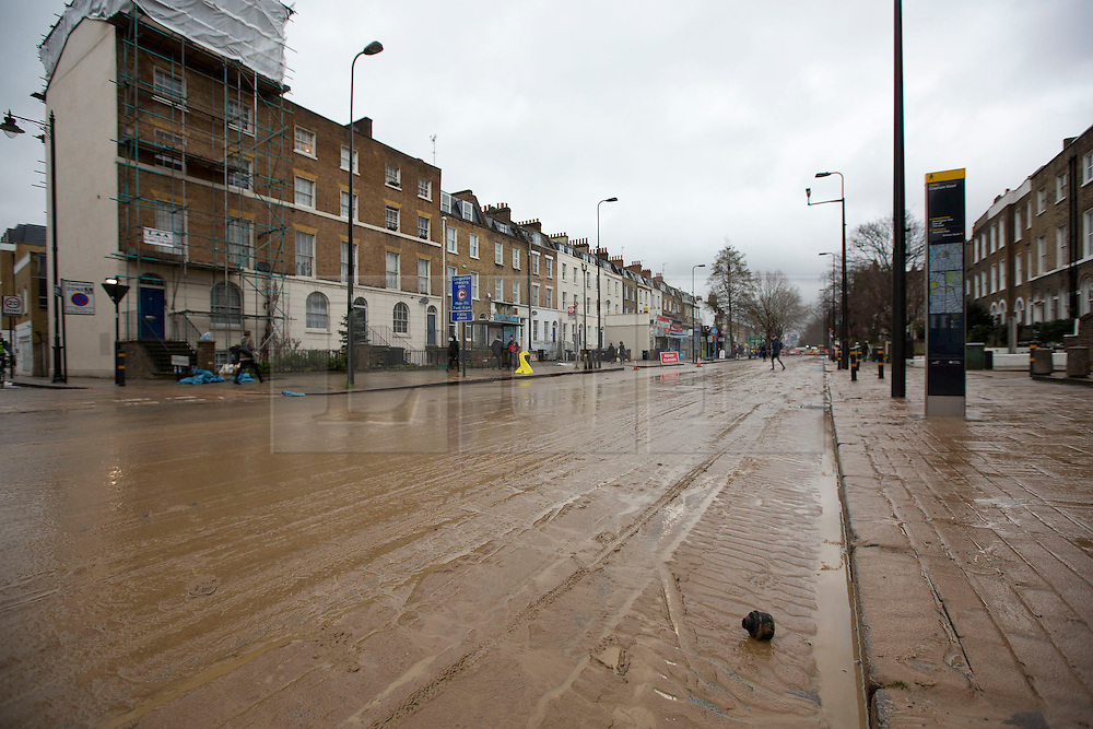 © Licensed to London News Pictures. 28/02/2014. London, UK. Water and debris are seen on Clapham Road in Kennington, London today (28/02/2014) after a watermain burst yesterday evening. The flooding, along one of the main routes in and out of the centre of the city, has today caused widespread disruption to traffic. Photo credit: Matt Cetti-Roberts/LNP