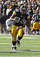 October 22, 2011: Iowa Hawkeyes running back Marcus Coker (34) on a run during the first half of the NCAA football game between the Indiana Hoosiers and the Iowa Hawkeyes at Kinnick Stadium in Iowa City, Iowa on Saturday, October 22, 2011. Iowa defeated Indiana 45-24.