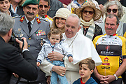 April 26, 2017 : Pope Francis poses with some children and cyclists at the end of his weekly general audience in St Peter's square at the Vatican .Antoine Mekary | Aleteia | I.Media