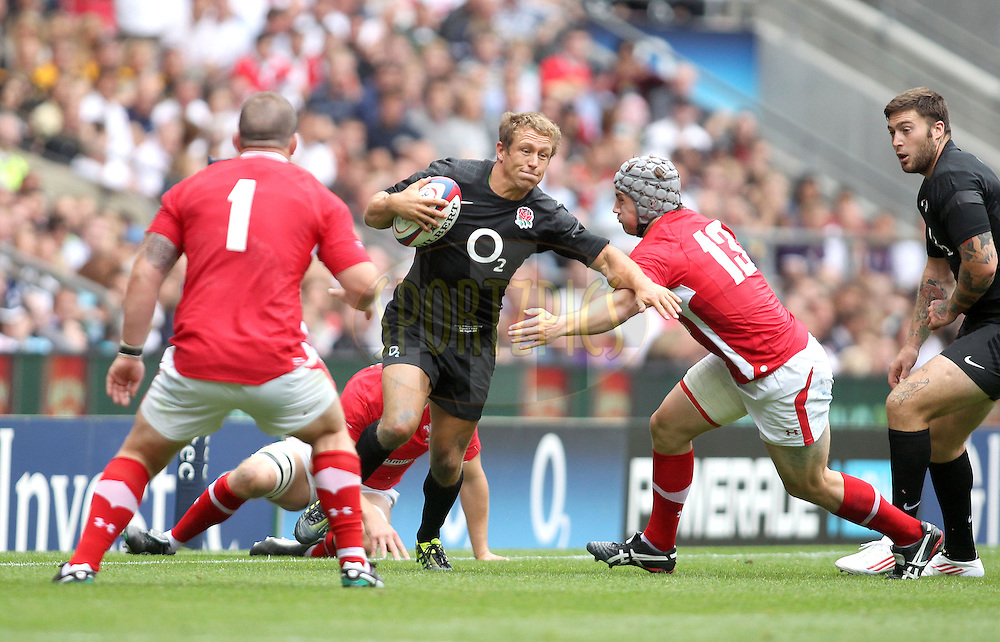 © Andrew Fosker / Seconds Left Images 2011 -  England's Jonny Wilkinson cuts between Wales' Jonathan Davies (R) & Paul James (L) England v Wales  - Investec International - 06/08/2011 - Twickenham Stadium  - London - All rights reserved..