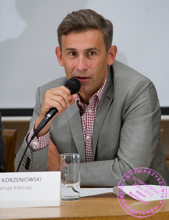 """Robert Korzeniowski former Polish racewalker and four gold medalist. Three times of the 50km walk at the Summer Olympics. He won 1996 in Atlanta, 2000 in Sydney, and 2004 in Athens. He also won the 20km title at the 2000 games in Sydney. .Robert Korzeniowski during press conference before event for runners called """"Biegnij Warszawo 2012"""" at Return Cafe in Warsaw on September 18, 2012...Poland, Warsaw, September 18, 2012..Picture also available in RAW (NEF) or TIFF format on special request...For editorial use only. Any commercial or promotional use requires permission...Photo by © Adam Nurkiewicz / Mediasport"""