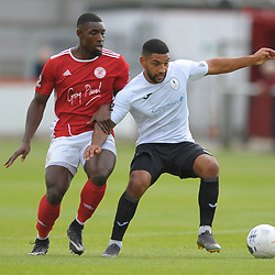 TELFORD COPYRIGHT MIKE SHERIDAN Ellis Deeney of Telford holds off Lee Ndlovu during the National League North fixture between Brackley Town and AFC Telford United at St James's Park on Saturday, September 7, 2019<br /> <br /> Picture credit: Mike Sheridan<br /> <br /> MS201920-016