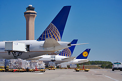 Continental and Lufthansa jets being loaded with cargo at Houston's Intercontinental Airport