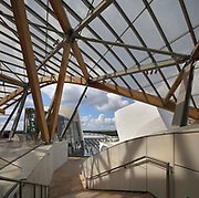 Staircase and terraces under the glass 'sails' of the Fondation Louis Vuitton, an art museum and cultural centre designed by Frank Gehry, b. 1929, and built 2008-14, next to the Jardin d'Acclimatation in the Bois de Boulogne, in the 16th arrondissement of Paris, France. The building resembles the sails of a boat and houses 11 galleries, an auditorium seating 350 and roof terraces. Picture by Manuel Cohen
