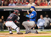 CLEVELAND, OH - NOVEMBER 1, 2016: Ben Zobrist #18 of the Chicago Cubs slides safely home and scores off of a two-run double hit by teammate Addison Russell #27 during Game 6 of the 2016 World Series against the Cleveland Indians at Progressive Field on November 1, 2016 in Cleveland, Ohio. (Photo by Jean Fruth)