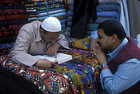 merchants reading the Koran, Cairo - Egypt
