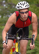 Scott Dean of Naperville, Illinois works to pick up speed heading into the final long straightaway of the second leg of the inaugural Little Traverse Triathlon in Harbor Springs, Michigan.