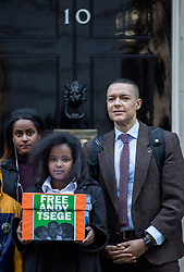"© Licensed to London News Pictures. 29/11/2016. London, UK. Helawit Hailemariam, Menabe Andargachew, Clive Lewis MP [Left to Right] bring a petition to Downing Street calling on the Prime Minister to seek the release of British man Andargachew ""Andy"" Tsege, who is in his sixties, who is in prison in Ethiopia under the shadow of a death sentence. Andargachew Tsegehas been detained in the country since he was removed from an airport in Yemen in June 2014. The father-of-three, who fled the country in the 1970s and sought asylum in the UK in 1979, had been a prominent critic of Ethiopia's ruling party. Photo credit : Tom Nicholson/LNP"