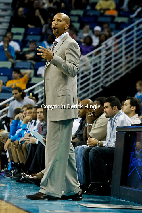 October 9, 2010; New Orleans, LA, USA; New Orleans Hornets head coach Monty Williams watches from the bench during the second half of a preseason game against the Memphis Grizzlies at the New Orleans Arena.The Grizzlies defeated the Hornets 97-90. Mandatory Credit: Derick E. Hingle