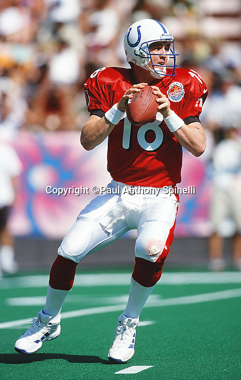 AFC Indianapolis Colts quarterback Peyton Manning (18) drops back to pass during the NFL Pro Bowl Football game against the NFC on Feb. 6, 2000 in Honolulu. The NFC won the game 51-31. (©Paul Anthony Spinelli)