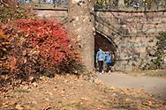 A young couple heading into Greywacky Arch in Central Park.